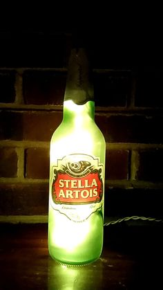 Very cool Stella Artois Lager Beer Lighted bottle lamp with lights in it. great for the home. measures 10 1/2″ x 3/4″ wide See more at lightitupcreations.com  Purchase this on Etsy!