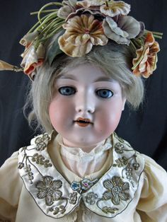 "This blue-eyed lovely has markings on the back of her head: ""Made in Germany - Armand Marseille - 390n- DRC'M. 246/1 - A.10. M"" Some research online shows that these dolls were produced roughly between 1885 and 1930. 