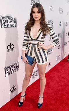 Actress Hailee Steinfeld strikes a pose in a stunning Zuhair Murad romper at the end of the red carpet during the 2015 American Music Awards in Los Angeles on Nov. 22, 2015.