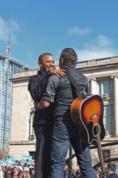 Bruce Springsteen Photos - Rocker Bruce Springsteen (R) welcomes U.S. President Barack Obama to the stage during a rally on the last day of campaigning in the general election November 5, 2012 in Madison, Wisconsin. Obama and his opponent, Republican presidential nominee and former Massachusetts Gov. Mitt Romney are stumping from one 'swing state' to the next in a last-minute rush to persuade undecided voters. - Obama Campaigns In Midwest Swing States One Day Before Election Day