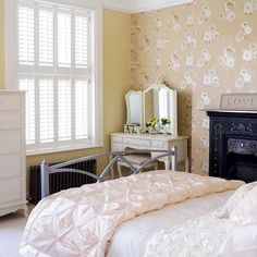 Pale yellow French bedroom