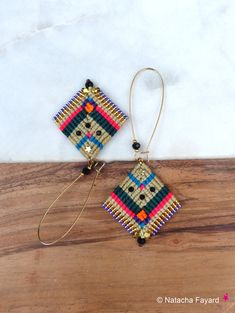 Boho chic style for those macrame woven earrings, made of polyester thread and miyuki delicas japanese seed beads. Designed and hand made in France, french designer jewelry. Sent with a hand made fabric jacket. Perfect for a gift. For your gift, I can add a wish card, with few words
