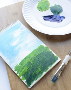Do you have a blossoming artist in your house? Have him make a beautiful #painting of an #Irish landscape. He'll have fun, and you'll have a unique #StPatricksDay #decoration too! #craftsforkids #artforkids