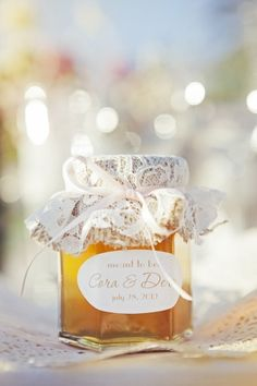 lace covered, personalized jar of honey as wedding favor, photo by Duke…