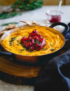 This butternut squash dip is made with goat cheese and cream cheese for a super creamy texture then topped with a festive tart cherry compote. Serve it with some pita chips for the perfect holiday appetizer!