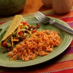 Sautéed onions and bell peppers in tomato-seasoned rice