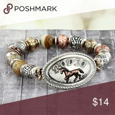 """'Rodeo' Beaded Stretch Bracelet Add western flair to your outfit!  Burnished Silvertone, Goldtone, and Coppertone Up to 1"""" Wide 2.25"""" Diameter 1.5"""" Oval?Plate with Raised """"Rodeo"""" and?Horse Multi-Textured Beads Comfort Stretch Band Lead & Nickel Compliance Justin Boots Jewelry Bracelets"""