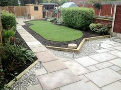 Back garden with paving and lawn