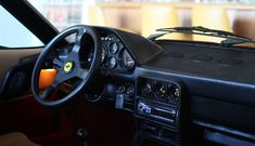 The steering wheel of the Ferrari 308 at Garage 77 in Los Angeles Ferrari, Garage, Cars, Vehicles, Carport Garage, Autos, Garages, Car, Car