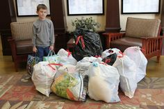 """GIVING GIFTS -- When Kimber Haggard's mom (Stacy Bingham) asked what kind of party he would like for his 8th birthday, he asked her, """"Would it be weird if instead of getting presents, if I GAVE presents?"""" His proud mom told him that was a fine idea, so they asked party-goers to bring items for the kids at Northwest Arkansas Children's Shelter. The Siloam Springs lad and his family then brought about a dozen large bags, filled with toys and clothes. THANKS, Kimber!"""