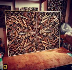 We already talked about the creations of artist Gabriel Schama, who assembles many layers of wood and other materials such as acrylic or leather, creating ama Mandala Design, Mandala Art, Diy Wall Art, Wood Wall Art, Tile Patterns, Pattern Art, Bohemian Headboard, Paper Structure, Cut Out Art