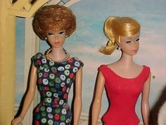 My Barbie had a bubble cut - but it was black hair (no wonder I wanted a Tressy doll - I couldn't do a darn thing with that bubble cut haired Barbie!