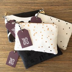 Wonderland by Alice Lane   Leather clutches in gold and black