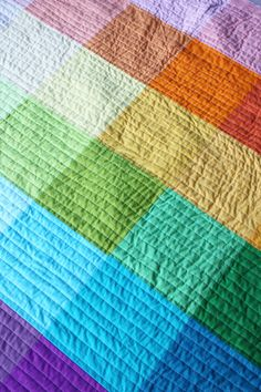 "rainbow quilt by Elise Blaha - 10"" squares with straight line quilting. LOVE"