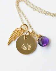 Baby Footprints Necklace in gold. Personalized condolence jewelry for miscarriage, stillbirth, and infant loss.  Necklace features an angel wing, baby's birthstone, and hand stamped footprints charm.  Four chain lengths available and all angel wing jewelry includes complimentary gift wrap.  Custom made sympathy gifts by Blue Room Gems.