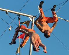 World photo/Mike Bonnicksen Trapeze performer Billy Tuthill, Wenatchee, at right, attempts a double flyaway Monday with Cole Tipton. Tuthill and Tipton are members of the Wenatchee Youth Circus — wenatcheeyouthcircus.com — now in its 61st season