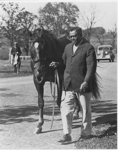 """Will Harbut led Man o' War in an undated photo. When Harbut died, one obituary listed survivors as """"his wife, six sons, three daughters and Man o' War."""""""