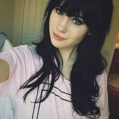 Pretty. Black hair, perfect bangs. Oh, green eyes too? God, being a bit unfair here :P