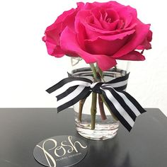 Pink roses with black and white stripes. Posh Floral Designs