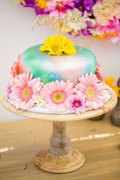 Flowery cake from Rainbowpalooza Tie Dye 1970s Inspired Birthday Party at Kara's Party Ideas. See more at karaspartyideas.com!