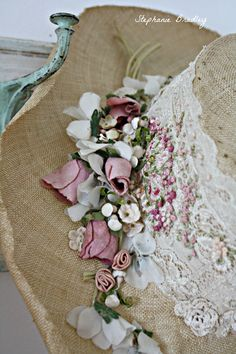 A beautiful vintage hat with lace, millinery flowers, and knot work. This was quite a find !