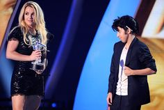 Britney Spears decides she'd rather be friends with Jo Calderone/Lady Gaga and backs off before accepting the Video Vanguard Award at the 2011 MTV Video Music Awards in Los Angeles. | MTV Photo Gallery