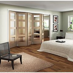 Ashton folding interior doors allow you to quickly and easily create open space or divide an area in to separate rooms. A contemporary twist on traditional interior doors Room Divider Headboard, Metal Room Divider, Small Room Divider, Room Divider Bookcase, Bamboo Room Divider, Living Room Divider, Room Divider Walls, Diy Room Divider, Divider Cabinet