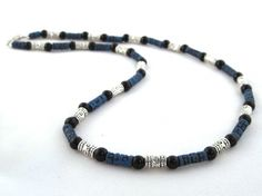 Confidence and peace men's necklace $19.00 Carved blue colored Sono wood, black onyx, and Tibet silver beads combined together for a trendy look. The necklace is strung onto tigers tail wire for strength, durability and drape. Finished off with a barrel screw clasp.