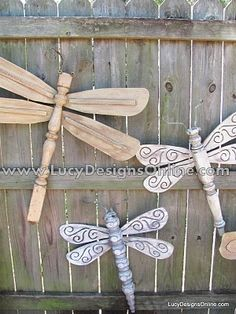 Repurposed Table Leg & Ceiling Fan Dragonflies....great backyard or garden fence decor.
