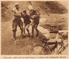 Tour de France 1937. 8^Tappa, 8 luglio. Grenoble > Briançon. La maglia gialla Gino Bartali (1914-2000) è caduto in discesa durante l'attraversamento di un ponte sul torrente Colau, nei pressi di Embrun, quand'era alla ruota di Jules Rossi (1914-1968), caduto per primo e poi costretto al ritiro. Lo aiuta a rimettersi in sella Francesco Camusso (1908-1995). Dirà all'arrivo un Bartali sofferente < se non si perde un braccio, al Tour non sono ferite! >, ma il suo Tour sarà compromesso [Match]