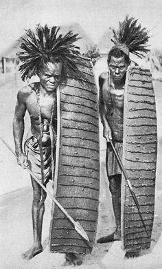 Africa | Lega warriors.  Belgian Congo || Vintage postcard; ca. 1920/30