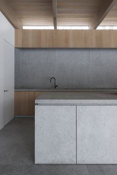 Neutral tones, gray palette, wood, concrete kitchen