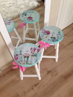 Painted bar stools with Kathryn White art decoupaged onto them