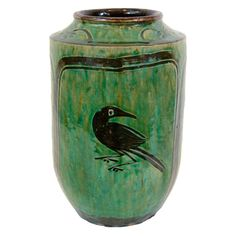 Late 19th Century Chinese ceramic jar with hand crafted bird and floral images. From Hunan Province.