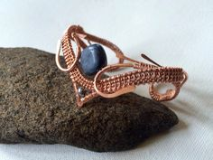 A personal favorite from my Etsy shop https://www.etsy.com/listing/276743036/copper-wire-wrapped-cuff-bracelet