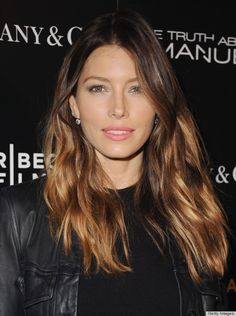 Jessica Biel's beachy hair, matte face makeup, subtle glitter eyeshadow and pink lipstick add a feminine flair to her leather jacket.