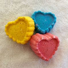 Home made all natural bath bombs. These smell heavenly! Made with Baking Soda, Epson salts, Kaolin Clay, Coconut Oil, Shea butter, and color (mica mineral powder) . Very moisturizing!! Topped with a bit of glitter.  You can choose between  large hearts,  mini shapes (3 to a set, I choose shap...