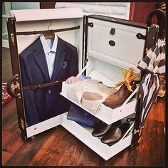 Getting ready for the weekend. Luggage and dress clothes weekender. Business professional. Luxury travel.