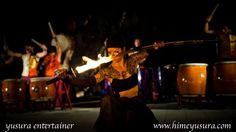 She turned quickly as she sheathed her flaming sword. https://www.facebook.com/YusuraCircus