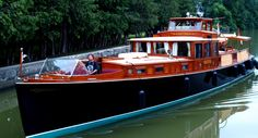 This is perhaps the finest looking boat on the NY Canals. She is the 1929 Consolidated Commuter Yacht Dolphin, a 66' mahohany beauty.