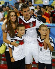 Germany's Klose gathers with his family after the team won their 2014 World Cup final against Argentina in Rio de Janeiro