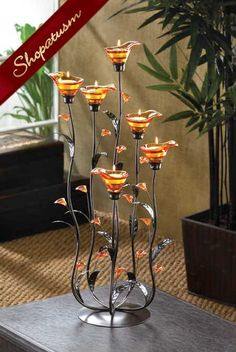 DSHD-Amber Calla Lily Candleholder Slender curving stems support iridescent amber lily blossoms, creating an elegant play of form and color. Place a candle into each bloom to enhance the night with dazzling light!Buy Amber Calla Lily Candle Holder at Candle Stand, Tealight Candle Holders, Candle Lanterns, Tea Light Candles, Tea Lights, Candleholders, Candlesticks, Candle Cups, Candle Wedding Centerpieces