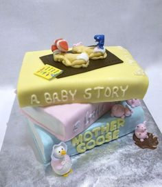 Twins baby shower cake for a storybook themed baby shower.   Yellow Cake with Chocolate Ganache filling.