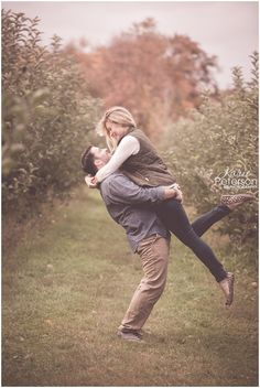 fall apple orchard engagement photo