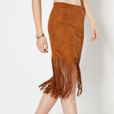 ☀️Cognac suede & fringe skirt Cute faux suede & fringe skirt We're loving the look of rustic luxe right now, like this soft faux suede skirt. Built in a flattering cut, his trendy skirt features a deep fringe hem that sways with every step.   Hidden side zipper 100% polyester Skirts