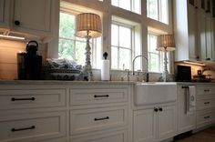 Beautiful southern cottage designed by Bob Chatham and built in Fairhope, AL by Scott Norman. Kitchen Farm Sink Natural Daylight Windows | www.bobchatham.com | Copyright by Designer.