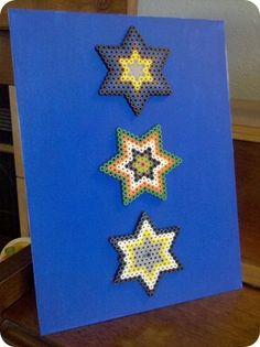 Perler beads art work - aha! my kids are so proud of their creations, & I didn't know what to do with them!