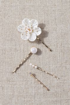 This set of pins features pearl beading with floral accents, for either a touch of shine or full-on glam. Bhldn Wedding, Hair Beads, Bridal Shoes, Bridal Gowns, Pearl Beads, Cute Fashion, Hair Pins, Headpiece, Hair Accessories