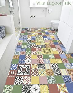 You could't decide on one? TAKE THEM ALL!!! Patchwork Cement Tile Bathroom Floor.