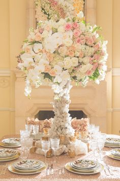 Tall, Elegant Centerpiece with Roses, Hydrangeas, & Orchids |  Photography: Thisbe Grace Photography. Read More: http://www.insideweddings.com/weddings/inspirational-wedding-shoot-inspired-by-geology-glam-textures/678/